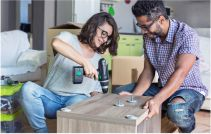Couple building some furniture units for the new home royalty-free stock photo