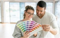 Couple painting their house royalty-free stock photo