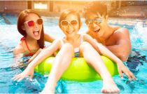 Happy family playing in swimming pool royalty-free stock photo