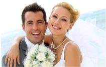 Smiling bridal couple with bouquet of flowers