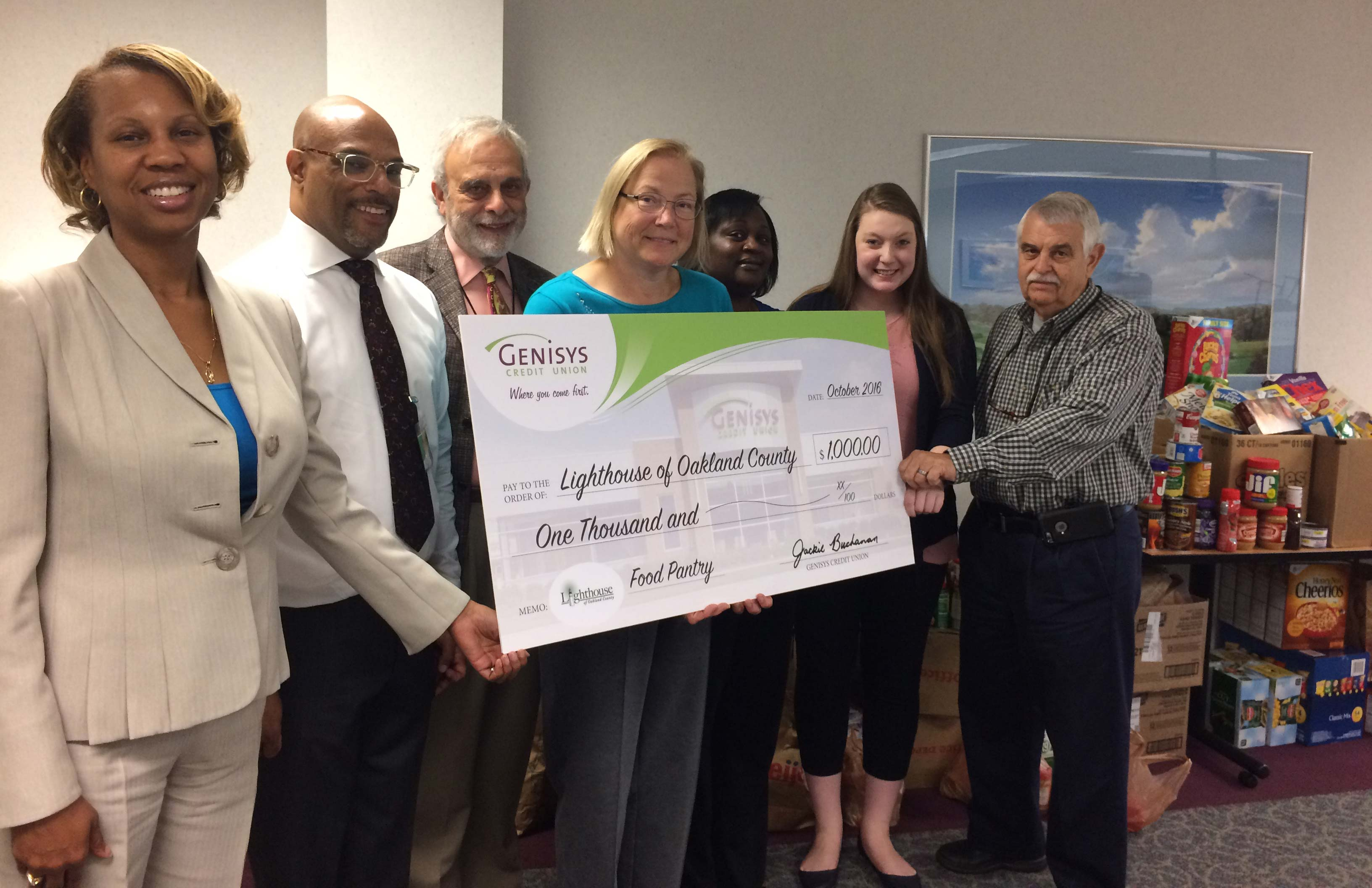 Staff presenting check for Lighthouse