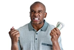 Frustrated man holding a stack of money