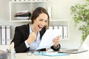 Young woman excited about her pay raise