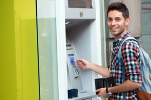 Young man using the ATM