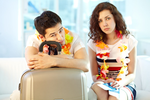 Frustrated couple with luggage