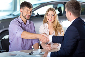 Man shaking hands with salesman