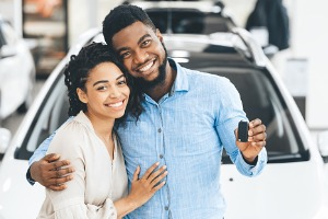 Couple Smiling With Car Keys