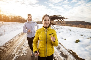 Couple running outside in winter