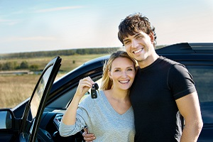 Couple Standing Outside of Car with Keys