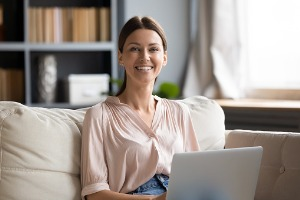 Adult Woman Smiling While at Computer