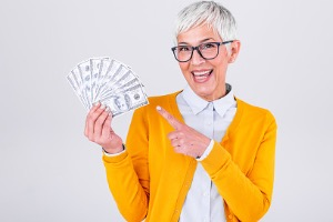 Mature Woman Holding Money