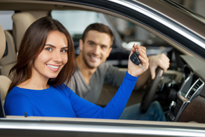 Woman holding keys to car
