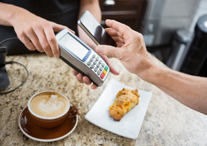 Person paying with mobile phone