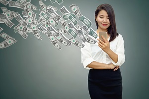Woman watching money fly out of her cell phone
