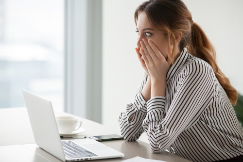 Surprised Woman viewing her account online