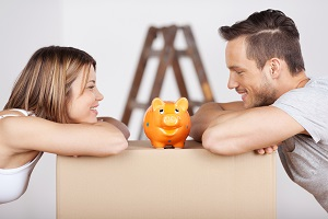 Young Couple looking at piggybank