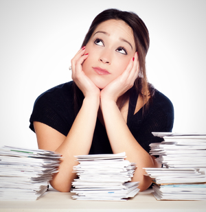 Woman thinking about how to organize her financial records