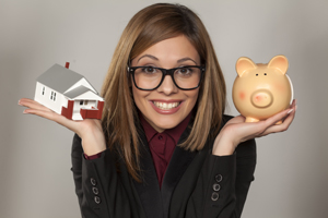Young Lady holding a piggy bank and toy house