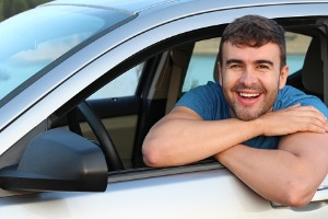 Young Man Smiling In Car