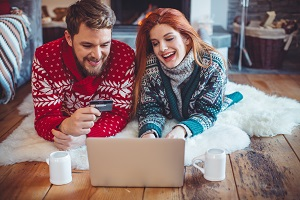 Young Couple Online Shopping During the Holiday Season