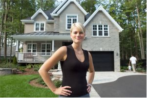 woman standing in front of new home