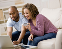 Couple looking at finances on computer