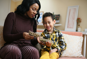 Mom teching son about saving money