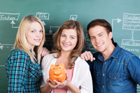 Teens with piggy bank