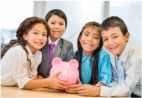 Young children holding a pigg bank